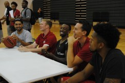 The players laugh.