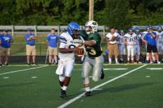 Senior Blake Carl tackles the Charlestown quarterback.