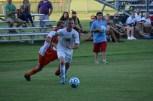 Senior Sean Brown moves the ball towards the net.