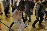 Senior Brandon Lacy dances in the gym. Photo by Delaney Smith.