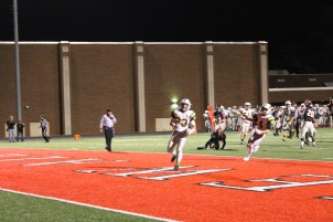 Senior Blake Carl runs into the end zone and scores a touchdown for the Highlanders.