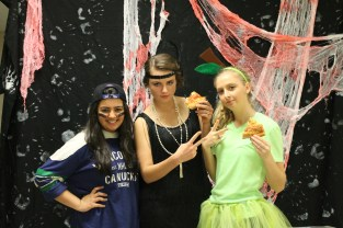 Junior Inaara Ladha as a sports fan (far left), senior Paige Vellinger, and senior Mikayla Koch (far right).
