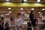 Junior Tyler Kimm shoots a layup.