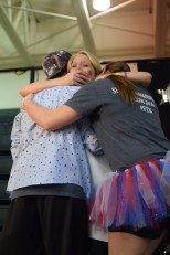 Seniors Justin Applebaum, Kylie Wheeler, and Kristen Burger have a group hug over the big reveal.