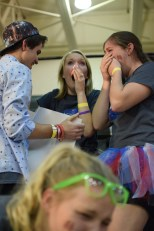 """Senior Justin Applebaum show seniors Kylie Wheeler and Kristen Burger final number of the total as they cry tears of joy. """"It was unexpected for everyone, and I didn't know what to expect,"""" said Applebaum."""