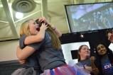 Senior Kristen Burger hugs senior Kylie Wheeler.
