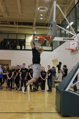 Senior Paden Pikey strikes a pose as he dunks the ball.