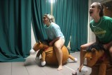 Juniors Kelsey Pinnick and Grace Phillips race to the finish line on exercise balls that were decorated to look like horses at after-prom. Photo by Kaitlyn Erdman.