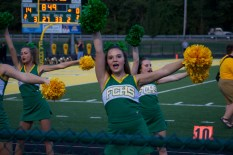 Senior Kendall Kaiser shows off her support for the football team late in the second quarter.