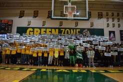 """The Green Zone is packed with students wearing gold and green for the """"Stripe the Stands"""" theme during the FC-Providence game. Photo by Braden Schroeder"""