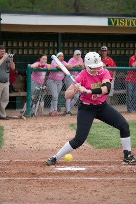Sophomore Cassie Thomerson watches the ball as it hovers right over the dirt and home plate.