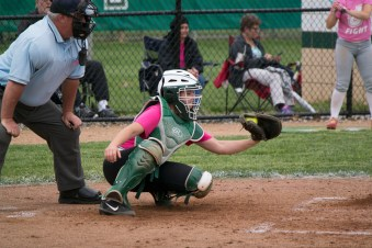 Sophomore Dallas Henderson extends her arm as the ball flies into her glove.