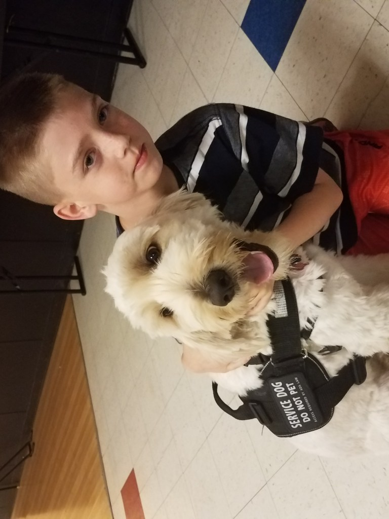 Young boy with emotional support animal