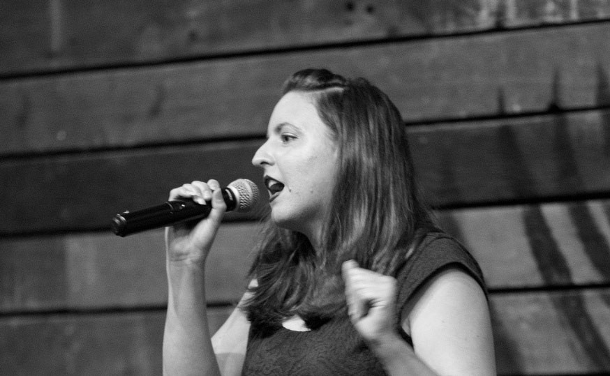 A woman singing at an event
