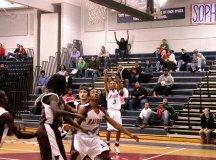 STUART'S DOMININIQUE KOSH (3) unleashes a jumper, while Raymond Watson awaits a rebound. (Photo: News-Press)