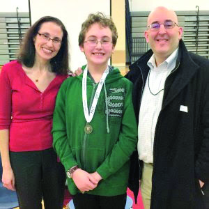 MARY ELLEN HENDERSON's JACK RIFKIN (center) was the winner of the school's National Geography Bee competition on Tuesday. (Photo: FCCPS)