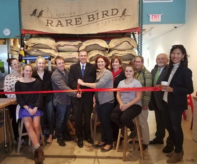 Falls Church Mayor Tarter, Vice Mayor Connelly, Council members Phil Duncan, Letty Hardi, and Karen Oliver, joined the Falls Church Chamber of Commerce and Rare Bird Coffee Roasters owners Lara Berenji and Bryan Becker for an official ribbon cutting on Thursday, October 13. (Photo: Sally Cole)