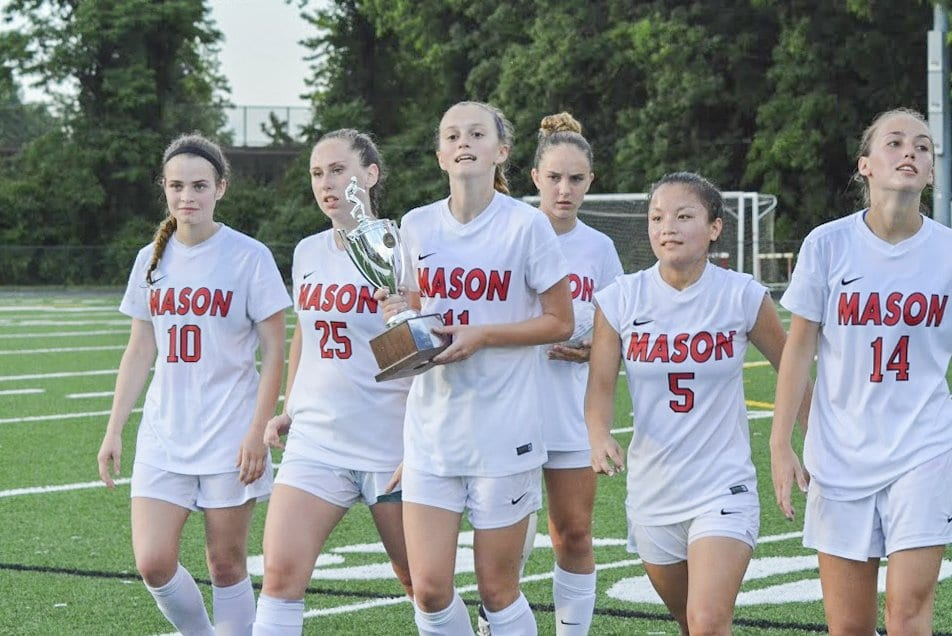 THE SENIORS ON MASON'S GIRLS soccer team walk off the field after receiving the Region 2A trophy upon defeating Goochland High School in regional championship. (Photo: Carol Sly)