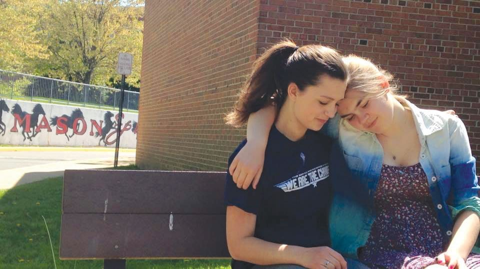 Sophomores Sarah Edwards and Rachel Skomra console each other while expressing their opinions on catcalling.  (Photo: Lasso)