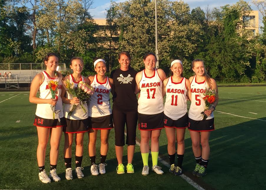 Head coach Courtney Gibbons with the seniors on Mason's girls lacrosse team, which posted their best season to date with a 14-4 overall record. (Courtesy Photo)