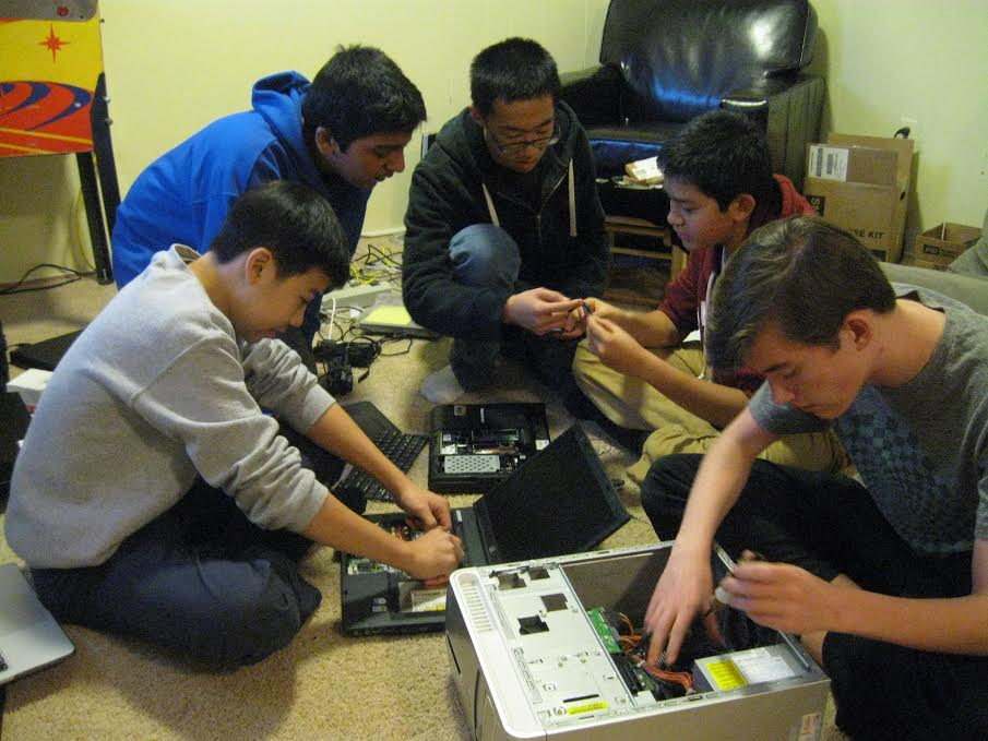 The Reboot for Youth team,  (l to r)  Christopher Cao, Shrikant Mishra, Peter Zhao, Arun Bhattasali and Griffith Heller, work refurbish computers. (Photo: Patricia Leslie/News-Press)