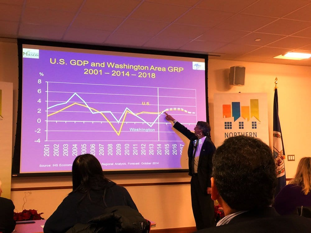 DR. STEPHEN FULLER, director of the Center for Regional Analysis at George Mason University, shows a graph indicating the D.C. area's dip below the national average for economic growth during his presentation at the Northern Virginia Association of Realtors Tuesday. (Photo: News-Press)