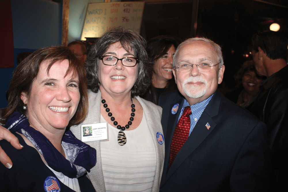 JODY ACOSTA (CENTER) CELEBRATES her victory in F.C.'s treasurer's race with F.C. councilmembers Marybeth Connelly and Phil Duncan at Clare & Don's Tuesday night. (Photo: News-Press)