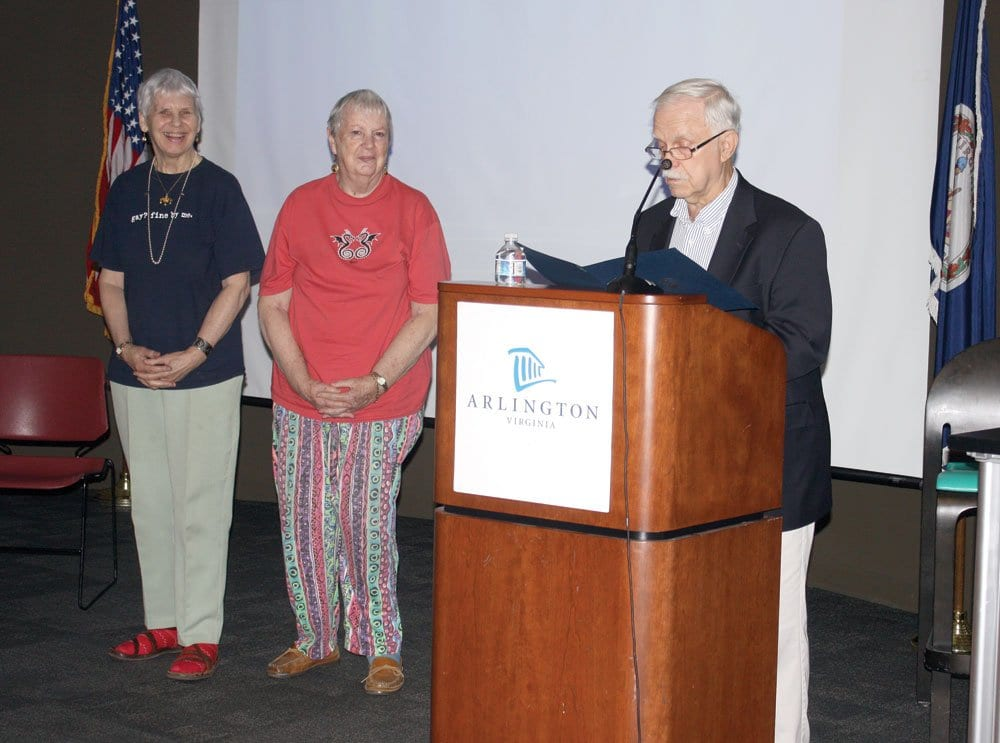 PIONEERING LGBT ACTIVIST Dr. Lilli Vincenz (left) and her partner of 30 years, Nancy Ruth Davis (center) receive applause as George Hobart (right) reads a proclamation from Arlington County Board chair Jay Fisette in Arlington this week. (Photo: News-Press)