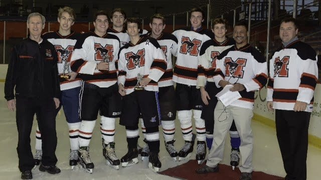 Celebrating the Mustangs' ice hockey seniors are, from left to right, Coach Stan Fendley; Seniors Jack Stricker, Connor Rhodes, Ian Rush (of Edison High School), Andrew Williamson, Adam Fendley, Matt Lowery, and Hunter Olson; and Principal Tyrone Byrd and Athletic Director Tom Horn. (Photo: Courtesy Monica Olson)