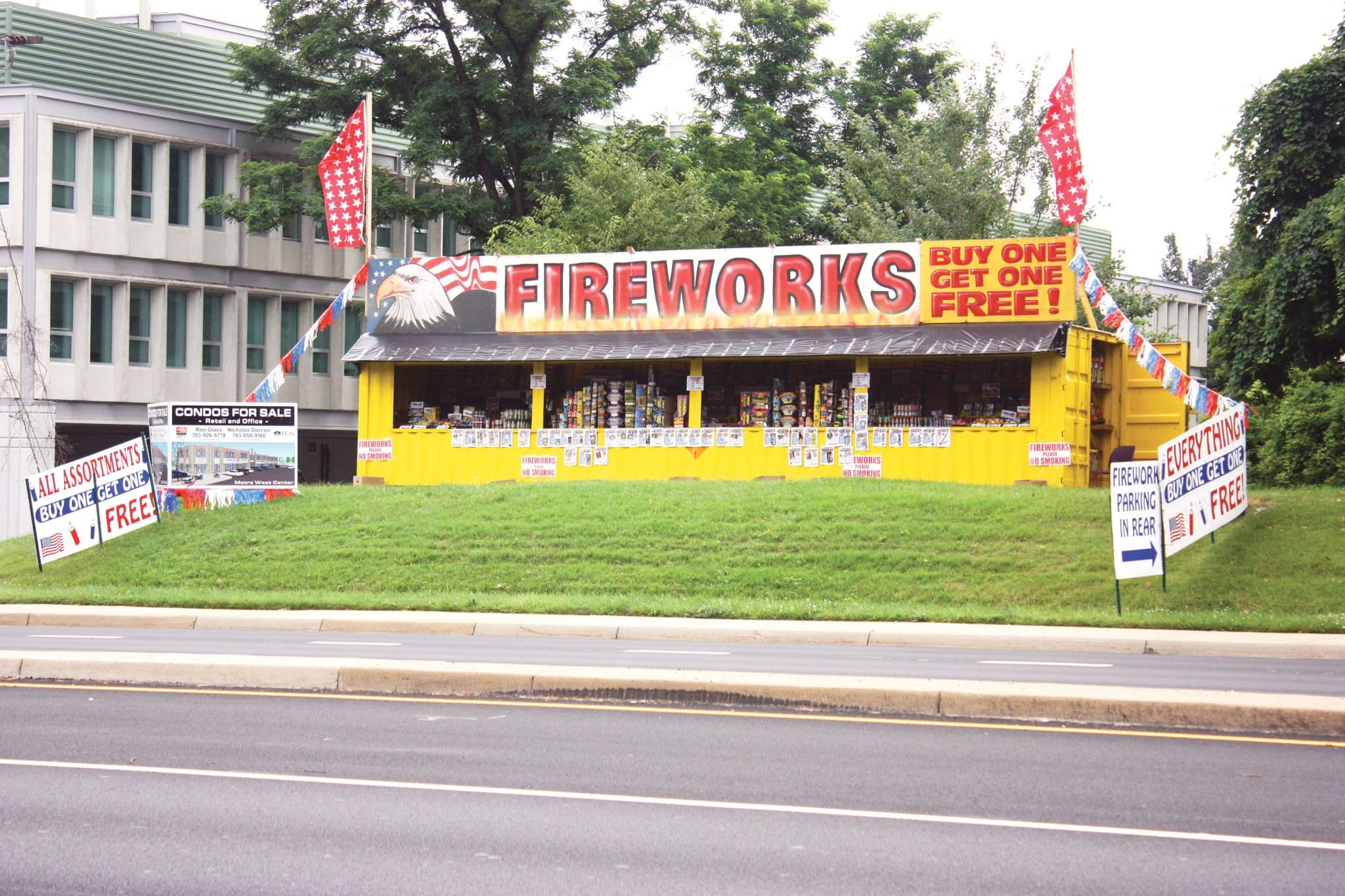 """THIS FAMILIAR FIREWORKS STAND has been set up on Route 7 just outside the city limits of Falls Church for many years. But this year, with F.C. now having its own fire marshal, after years of contracting that service from Arlington County, a stiff notice was sent out from City Hall last week warning that """"possession, manufacture, storage, sale and unauthorized use of fireworks are illegal in the City of Falls Church. This includes all consumer fireworks."""" Illegal are firecrackers, torpedoes, skyrockets, Roman candles, sparklers or other devices of like construction and any other devices containing any explosive or flammable compound. Violators are subject to prosecution of a Class 1 misdemeanor, as well as having fireworks seized. (Photo: News-Press)"""