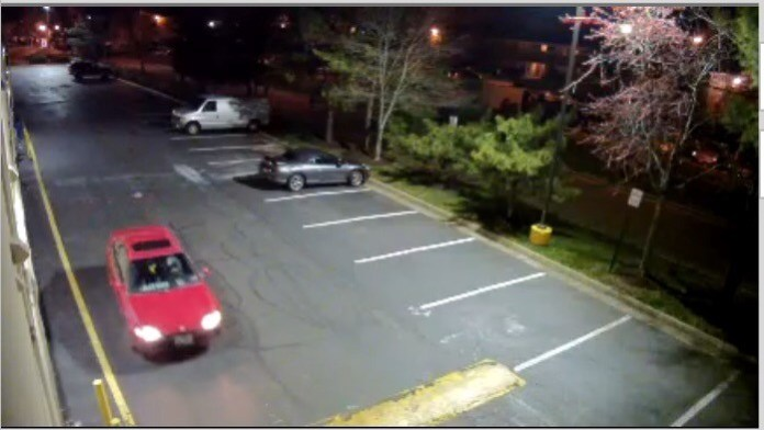 Older red vehicle (Surveillance Photo)