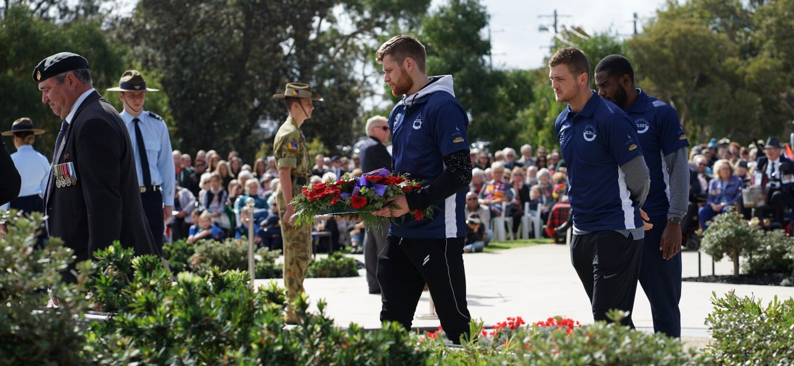 'LEST WE FORGET' AS FRANKSTON RSL BLUES MEN ATTEND ANZAC DAY DAWN SERVICES