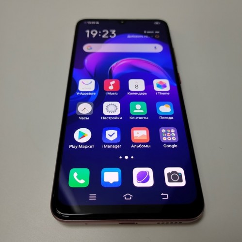 vivo V17 poses for the camera with a notched display and quad cameras