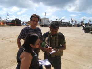 (standing left) Arman signing up to join the Philippine C-130 cargo plane to Manila