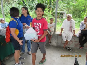 Young boy receiving food package for his family