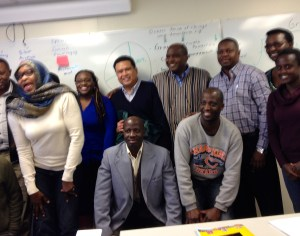 Mr. Dale Asis and Mr. Alie Kabba (back row center) participates in fundraising workshop with United African Organization participants