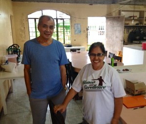 (left to right): Fr. Eutiquio Belizar  of Giporlos Catholic Church and Evelyn Castillo of Bayanihan Foundation