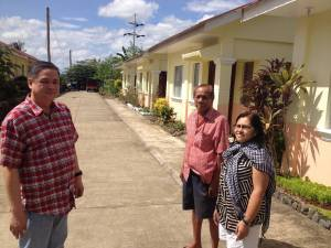 (left to right): Mayor Dr. Rufino Palabrica, Village Housing Association President; and Evelyn Castillo, Liaison of Bayanihan Foundation