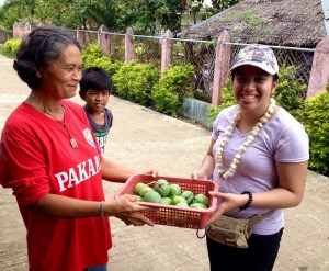 Jane Baron (far right) receiving a basket of green mangoes in Cebu