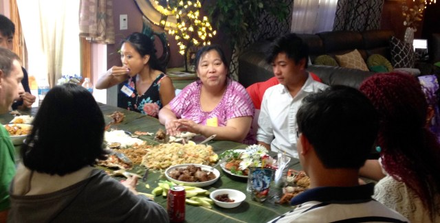 Guests enjoying Kamayan Feast (left to right): Brooke Reotutar, Vivian Santiago & Cyrus Santiago