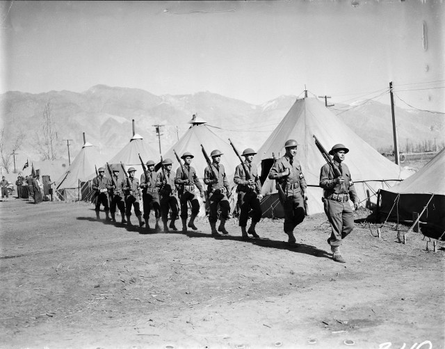 """A contingent of military police at the Manzanar Assembly Center. This """"assembly center"""" was later converted into a permanent """"relocation center."""""""