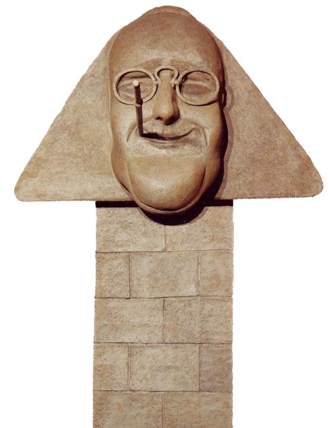 Sculpture of FDR as the Sphinx with glasses and a cigarette holder on a faux stone pedestal