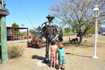 Kids checking out the sculpture out the front