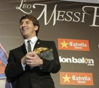 FC Barccelona's Lionel Messi poses with the Bota de Oro (Golden Shoe) trophy awarded to him as top scorer of all European Leagues, in Barcelona