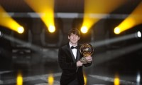 Argentina's Lionel Messi receives the FI
