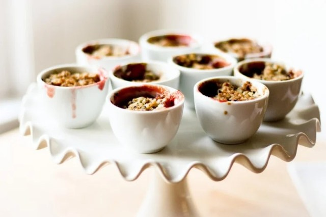 A simple dessert for entertaining -Mini Pear and Berry Crumbles with optional  Nigella seed, that can be made in advance in mini porcelain cups.