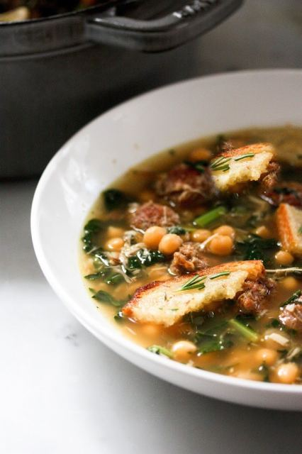 A brothy healing soup - Kale, chickpea and chicken soup with a toasty rosemary crouton. Simple and delicious. | www.feastingathome.com