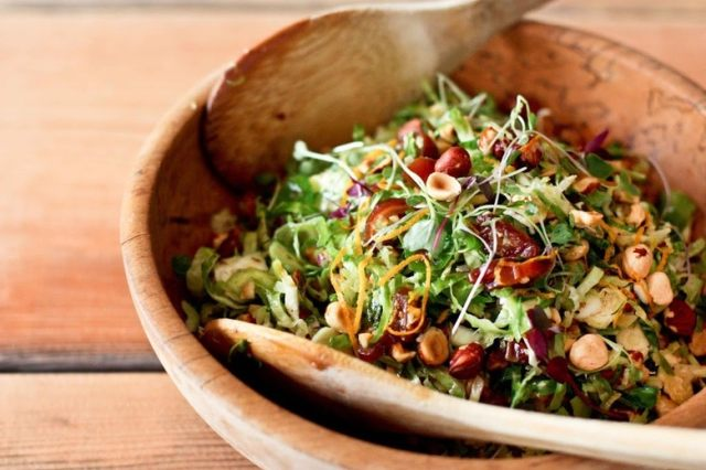 A simple tasty recipe for raw Brussel Sprout Salad with Hazelnuts and dates, vegan, healthy and a great combination of flavors.   www.feastingathome.com