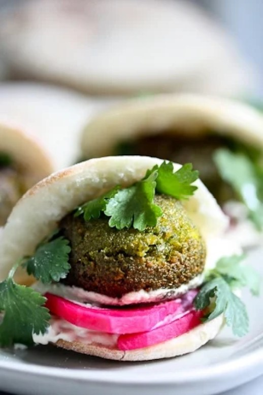 Falafels with Creamy Tahini Sauce,  homemade pita bread, Cucumber Yogurt Salad,  Pickled turnips! | www.feastingathome.com