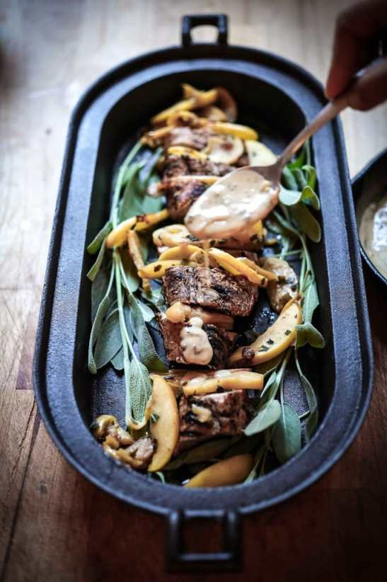 Grilled Pork with Hard Cider Pan Sauce, sautéed apples and sage. A delicious meal, perfect for fall. | www.feastingathome.com